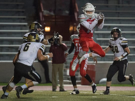 Bosse's Jayden Pease (15) makes a catch as Bosse High School and Boonville High School face off at Enlow Field in Evansville, Ind., on Friday, Oct. 20, 2017. Bosse won 20-14.