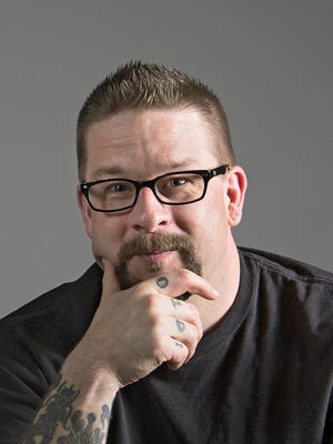 Grand View University professor and author of  The Tattooed Professor blog.