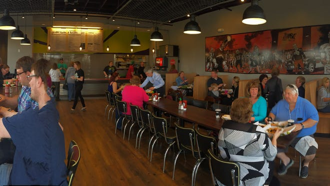 This panoramic view of Zombie Burger + Shake Lab in Ankeny shows the restaurant from the front entrance.