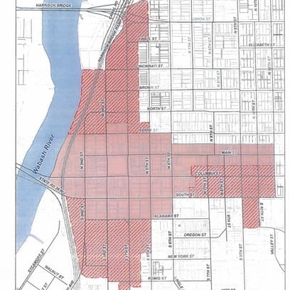 The red striped area is the expanded riverfront district