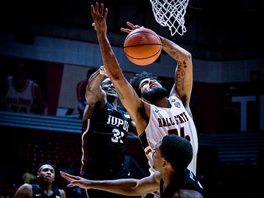 Ball State's Trey Moses takes a foul from IUPUI's defense