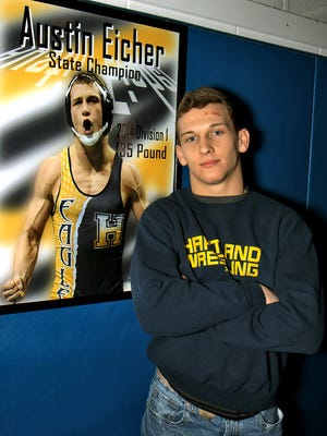 Austin Eicher made a name for himself in Hartland wrestling history by becoming the program's first three-time individual state finalist and second two-time champion.