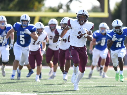 Don Bosco's Jalen Berger on his way to scoring a touchdown
