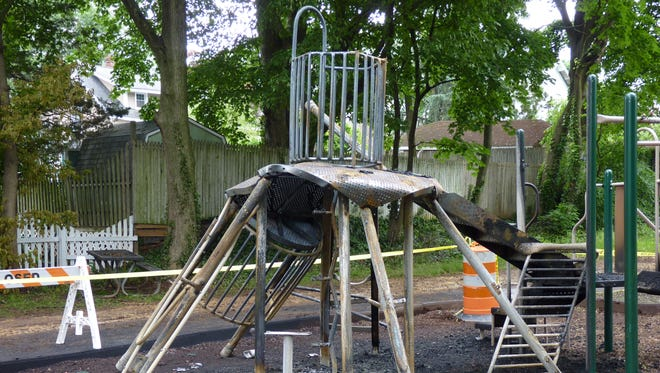 A mulch fire damaged a playground in Somerville on Friday.