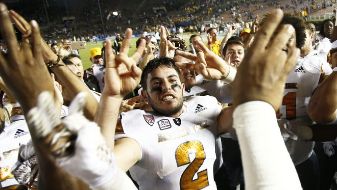 ASU's Mike Bercovici and the Sun Devils celebrate their victory over UCLA on Oct. 3, 2015 at the Rose Bowl in Pasadena, CA.
