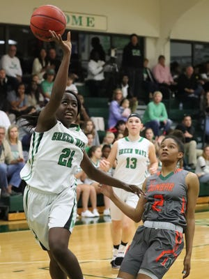 Autumn Giles looks to score for Fort Myers after beating Dunbar's Syanna Brown to the basket in the Dunbar at Fort Myers girls basketball game.