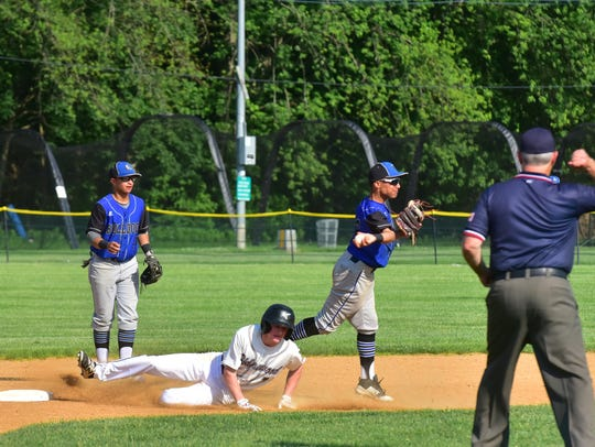 Passaic Tech shortstop Andy Rodriguez throws to first to complete a double play as second baseman Wildert Arias looks on in the North 1, Group 4 semifinals Tuesday at Ridgewood.