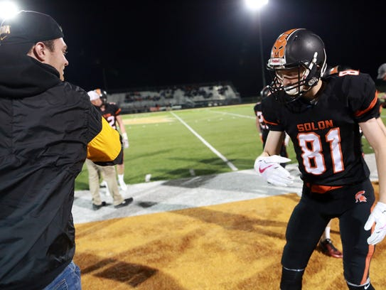 Solon's A.J. Coons gets a high-five from his brother,