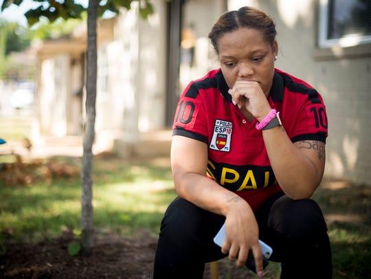 Sade Harris, mother of Timea Batts, sits outside a
