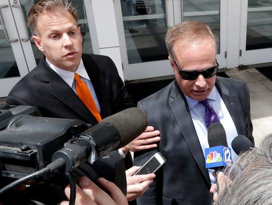 Spokesman Matt Benson, (left) moves his client, lobbyist