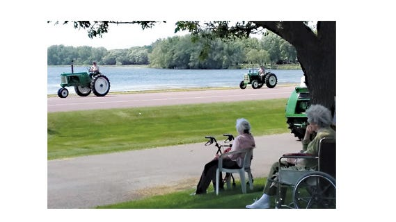 Residents of Divine Providence and Lake Villa Maria watched tractors leave their rode and head toward the Sleepy Eye Care Center on Sunday afternoon.