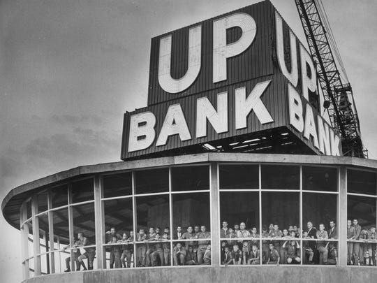 The Union Planters National Bank sign atop the 100 North Main building glowed for the first time May 11, 1965. On hand for the occasion were 51 representatives of Boy Scout Troop 97 of Whitehaven, who became the first group to hold a meeting in the Top of the 100 Club penthouse revolving restaurant.