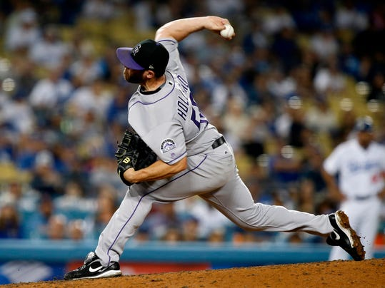 FILE - In this Sept. 8, 2017, file photo, Colorado Rockies relief pitcher Greg Holland throws to the plate against the Los Angeles Dodgers during the ninth inning of a baseball game in Los Angeles. A person familiar with the deal says All-Star closer Greg Holland and the St. Louis Cardinals have agreed to a $14 million, one-year contract. The person spoke on condition of anonymity Thursday, March 29, 2018, because the agreement was pending a physical and had not been announced.(AP Photo/Alex Gallardo, File)