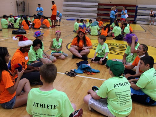 "Coaches and atheletes participate in an ice breaker activity during Race to the Finish, a ""field-day"" style event for special needs students K-8 in Parsippany, at Parsippany PAL Youth Center  Friday June 6, 2014."
