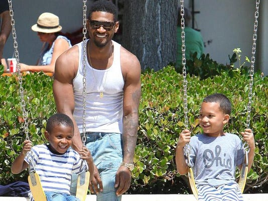 Usher with his sons