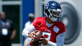 Titans quarterback Marcus Mariota rolls out to throw to a receiver during practice Tuesday, June 5, 2018 in Nashville, Tenn.