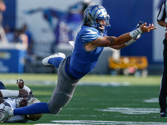 University of Memphis quarterback Riley Ferguson toss