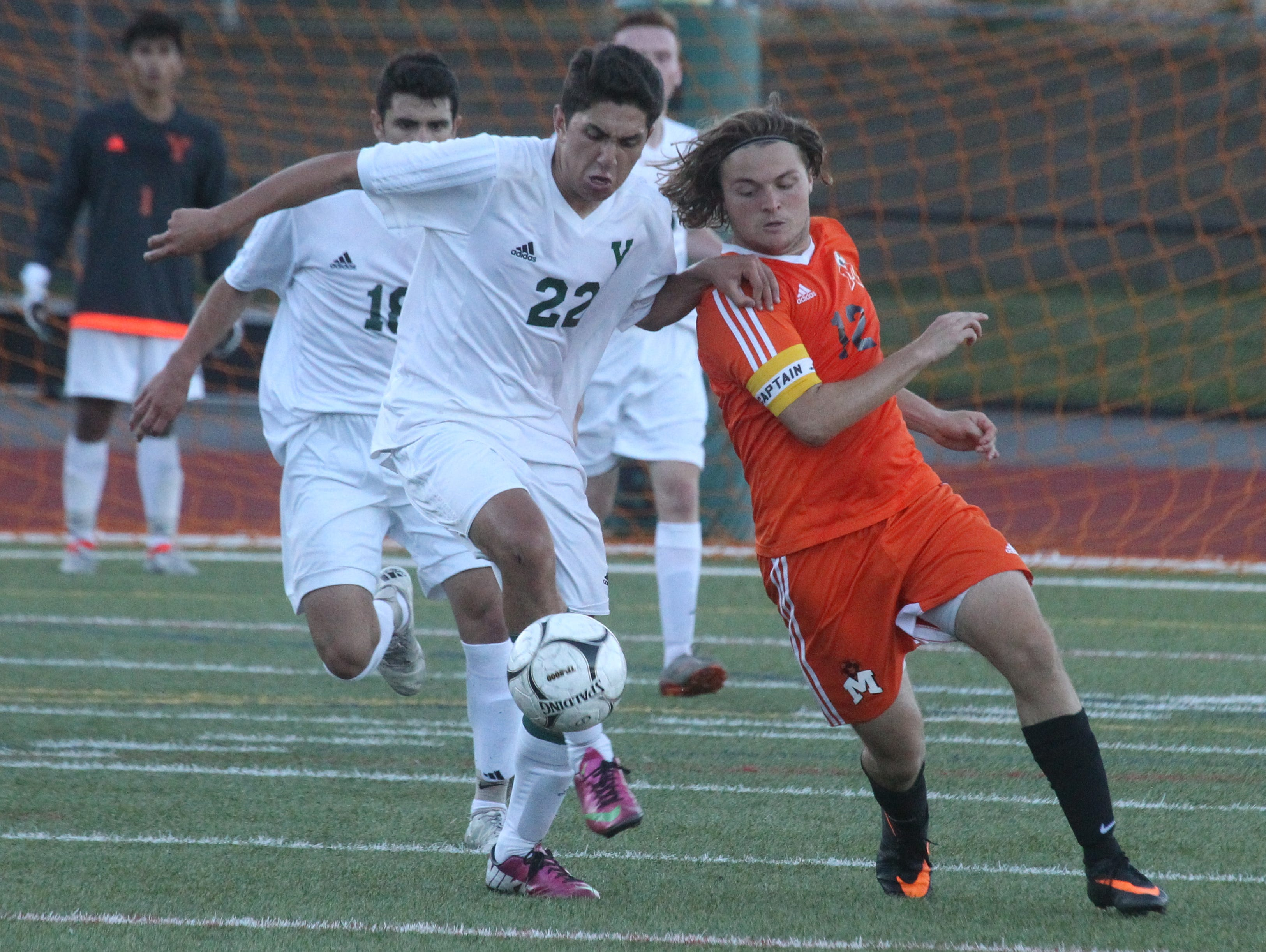 Yorktown's Ankit Patel, left, fights for the ball with Mamaroneck's Matt DiCicco during their game at Yorktown Sept. 12, 2016. Yorktown won 4-2.