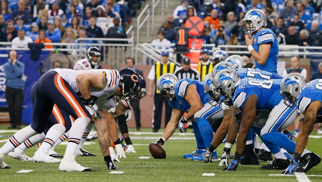 The Chicago Bears and the Detroit Lions face off on the scrimmage line during the second half of an NFL football game in Detroit, Thursday, Nov. 27, 2014.