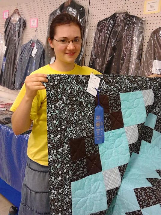 Joanna Hess of South Annville Township hold her handmade quilt that won a blue ribbon at the Lebanon Area Fair.