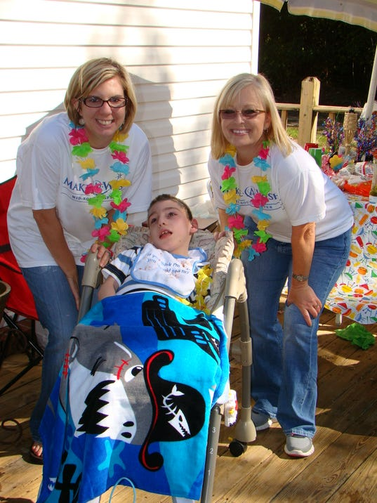 Amanda Maxwell, wish kid Dannan and MAW volunteer Lora Moore.JPG