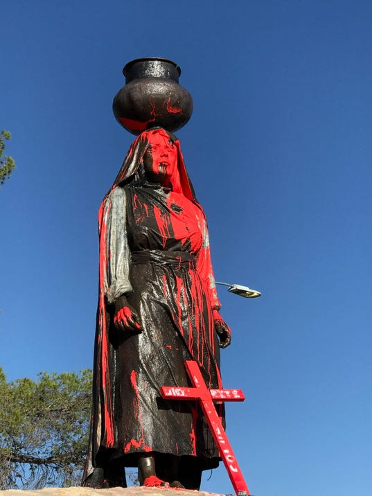 Tigua sculpture vandalized with red paint on Columbus Day