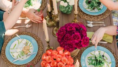 In this photo provided by Brian Patrick Flynn/HGTV.com, to keep gatherings easy going and enjoyable, the designer Flynn for HGTV.com Spring House suggests a casual outdoor table setting in which guests can help themselves and pass dishes and platters around the table family-style. (AP Photo/HGTV.com, Brian Patrick Flynn)