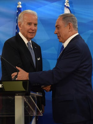 Vice President Joe Biden and Israeli Prime Minister Benjamin Netanyahu shake hands after giving joint statements in the prime minister's office in Jerusalem on March 9, 2016.