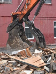 Workers demolished a storage building Monday, March 27, 2017 behind Chambersburg Borough Hall as expansion work is about to begin.