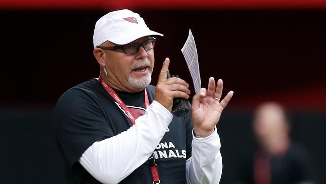 Cardinals coach Bruce Arians give a signal during training camp at University of Phoenix Stadium on July 30, 2014.