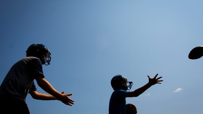 Essex High School's football team drills during their first practice earlier this summer.