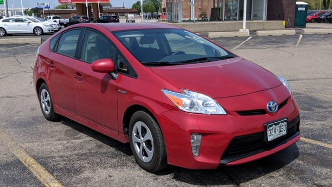La Roja the Prius looks lonely on a Warren car lot, where her owners sold her into an unknown future.