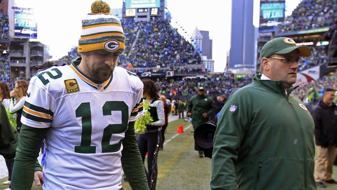 Green Bay Packers quarterback Aaron Rodgers leaves the field following a 28-22 overtime loss to Seattle in the NFC championship game on Jan. 18, 2015.