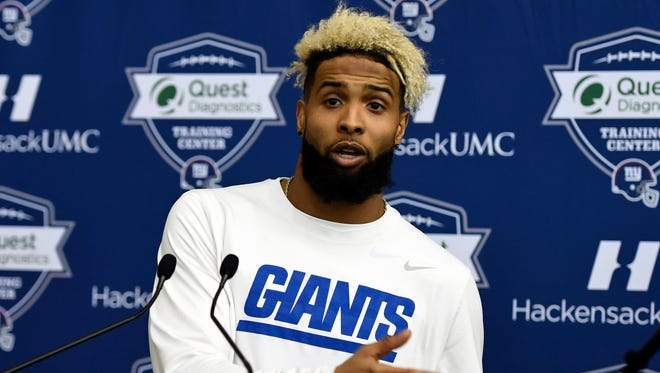 Odell Beckham Jr. made headlines recently for signing what might be the biggest shoe deal in NFL history -- and for his absence at voluntary off-seasons team workouts.