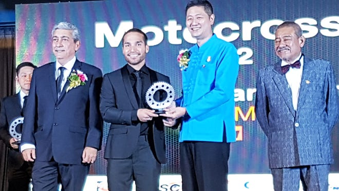 Sean Salas Lipanovich, second from left, is honored at the FIM Asia General Assembly in Bangkok, Thailand on Saturday. After more than a decade on the FIM Asia Motocross circuit in various divisions, he finally struck gold in 2017 and took home the 2017 Championship in the MX2 (125cc-250cc) division.
