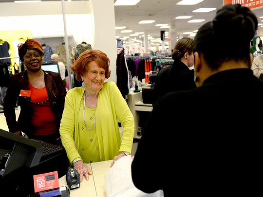 Betty Collette, 91, smiles as she talks with a customer Friday, Sept. 30, 2016 at the J.C. Penney store in the Lansing Mall. Collette is retiring after 67 years with the company.