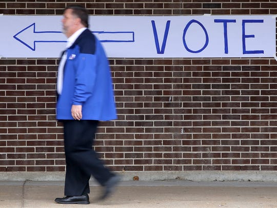 A voter makes his way to the polls on Election Day