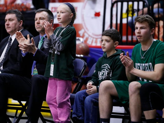 Hayden Bubble, 9, the daughter of Newfield's head coach