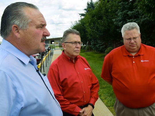 "Manitowoc Crane executives Barry Pennypacker, left, president/CEO, Pat Cassner, vice president manufacturing - Americas, and Les Middleton, senior vice president Americas mobile cranes chat with media on Wednesday, July 26, 2017. Department of Community and Economic Development Secretary Dennis Davin visited Manitowoc Cranes, Shady Grove, as part of Governor Tom Wolf's ""Jobs the Pay"" tour."