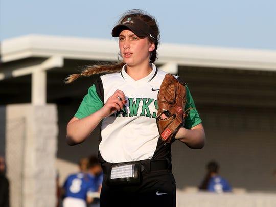 Iowa Park pitcher Erin Fairchild heads to the dugout on a changeover in the game against City View in the Iowa Park Tournament Saturday, March 3, 2018, in Iowa Park. The Mustangs defeated the Hawks 8-0.