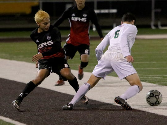 Wichita Falls High School's Martin Rangel goes after