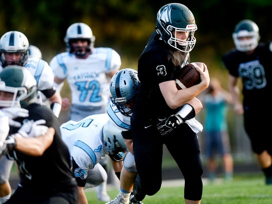 Williamston's Jackson Pollak runs for a gain against