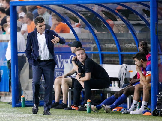 FC Cincinnati manager Alan Koch talks to the substitutes in the second half.