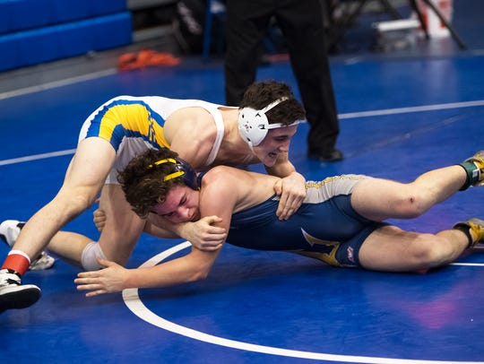 Greencastle's Ethan Zimmerman, bottom, tangles with