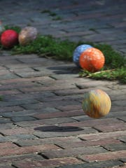 A bocce ball bounces down a brick-lined alley in the 4200 block between Broadway Street and Park Avenue.