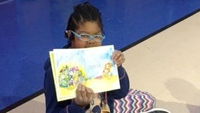 """Leia Elwess, a Hero Club member at Ruben S. Torres Elementary School, read a story related to """"kindness"""" to kindergarten students as part of the Great Kindness Challenge. The Great Kindness Challenge announces over 10 million students in over 13,000 schools in 90 countries are participating in The Great Kindness Challenge. This grassroots movement is proud to announce that """"Good Morning America"""" is showcasing The Great Kindness Challenge all week long, and schools are invited to send photos and videos of your students in action so that it can be shared far and wide. Photos or videos can be text to 760-846-0608 or emailed to jill@kidsfor peaceglobal.org. Send photos actual size. In subject line, print GMA photo from school name, city, state."""