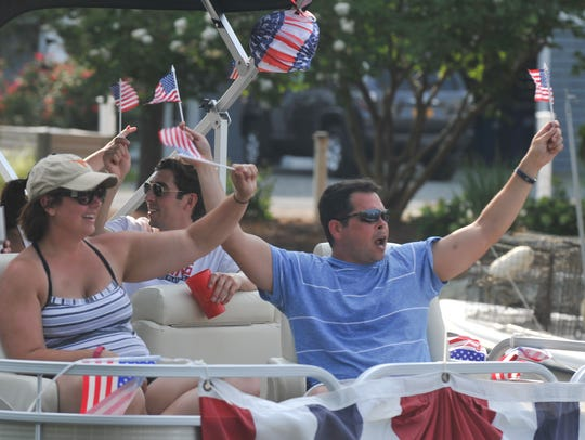 Participants show off their patriotism at the 2015 Boat Parade.