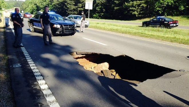 A sinkhole big enough to swallow a car has developed on a busy section of Mississippi Highway 6 in Oxford.
