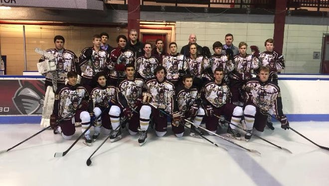 The Iona Prep hockey program raised $16,000 for charity and presented a check to Defending the Blue Line on Military Appreciation Night.