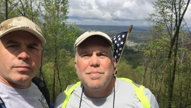 David Roth (left) and Kevin Winton walked across America to raise money for veterans and their families.